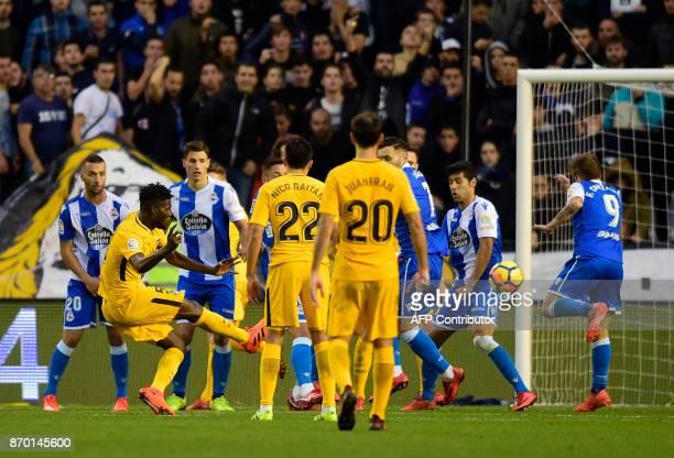 Atletico Madrid's Ghanaian midfielder Thomas Partey kicks the ball to score a goal during the Spanish league football match Deportivo Coruna vs...