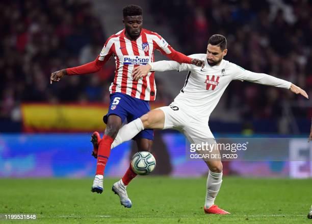 Atletico Madrid's Ghanaian midfielder Thomas Partey vies with Granada's Spanish midfielder Antonio Puertas during the Spanish league football match...
