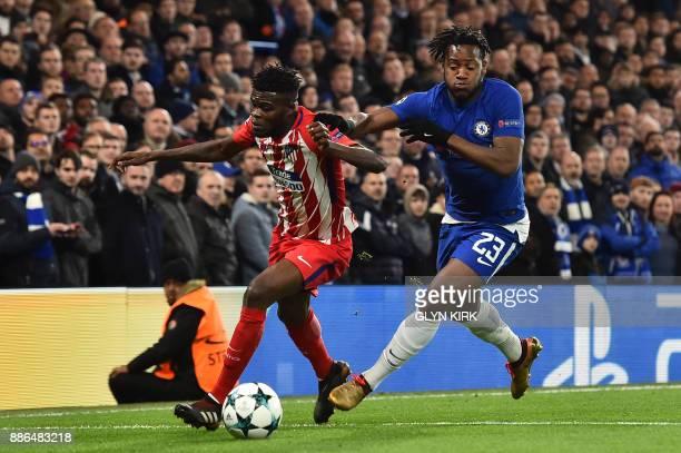 Atletico Madrid's Ghanaian midfielder Thomas vies with Chelsea's Belgian striker Michy Batshuayi during a UEFA Champions League Group C football...