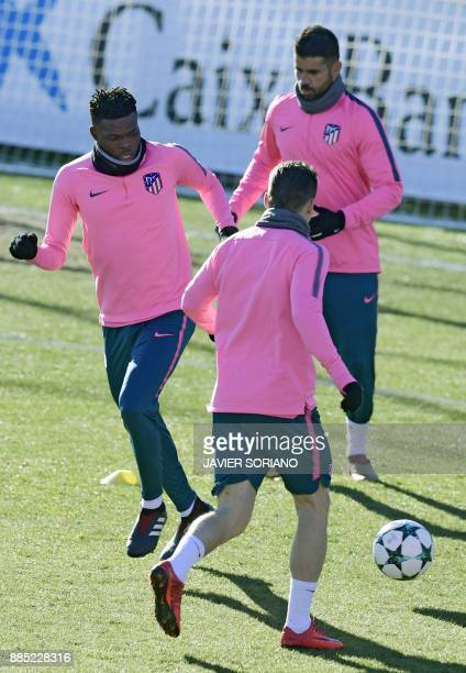 Atletico Madrid's Ghanian midfielder Thomas Partey and Atletico Madrid's SpanishBrazilian forward Diego Costa take part in a training session at...