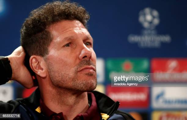 Atletico Madrid's head coach Diego Simeone holds a during Atletico Madrid press conference ahead of the UEFA Champions League match against Bayer 04...