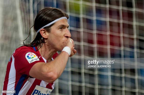 Atletico Madrid's Italian defender Filipe Luis celebrates after scoring during the Spanish league football match Malaga CF vs Club Atletico de Madrid...