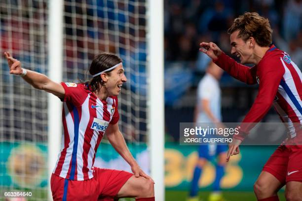 Atletico Madrid's Italian defender Filipe Luis celebrates with French forward Antoine Griezmann after scoring during the Spanish league football...