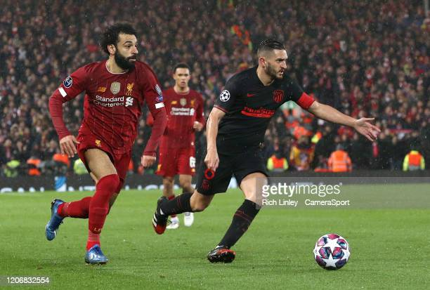 Atletico Madrid's Koke under pressure from Liverpool's Mohamed Salah during the UEFA Champions League round of 16 second leg match between Liverpool...