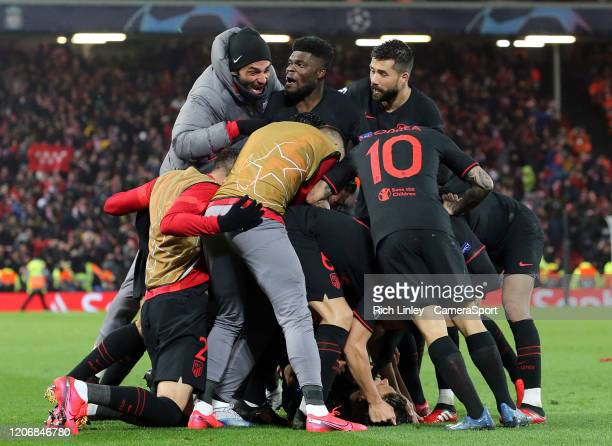 Atletico Madrid's Marcos Llorente is mobbed by teammates as he celebrates scoring his side's first goal during the UEFA Champions League round of 16...