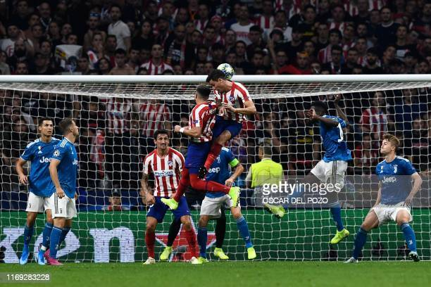 Atletico Madrid's Mexican midfielder Hector Herrera scores a goal during the UEFA Champions League Group D football match between Atletico Madrid and...