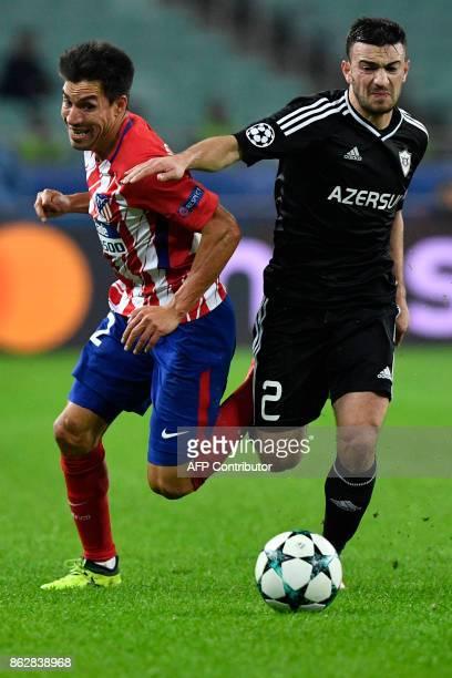 Atletico Madrid's midfielder from Argentina Nico Gaitan and Qarabag's defender from Azerbaijan Gara Garayev vie for the ball during the UEFA...