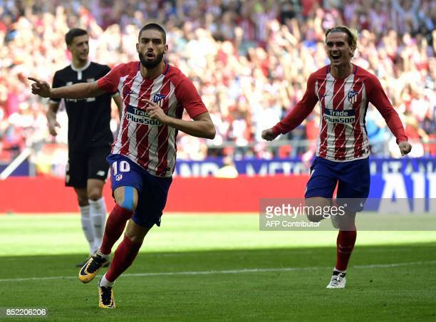 Atletico Madrid's midfielder from Belgium Yannick FerreiraCarrasco celebrates a goal beside Atletico Madrid's forward from France Antoine Griezmann...