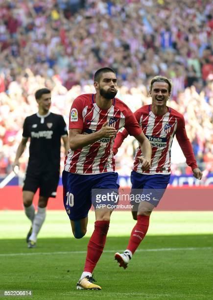 Atletico Madrid's midfielder from Belgium Yannick FerreiraCarrasco celebrates a goal beside Atletico Madrid's forward from France Antoine Griezmann...