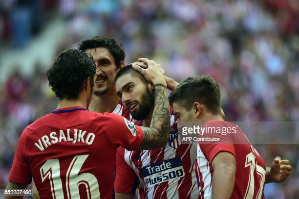 Atletico Madrid's midfielder from Belgium Yannick Ferreira-Carrasco celebrates a goal with teammates during the Spanish league football match Club...
