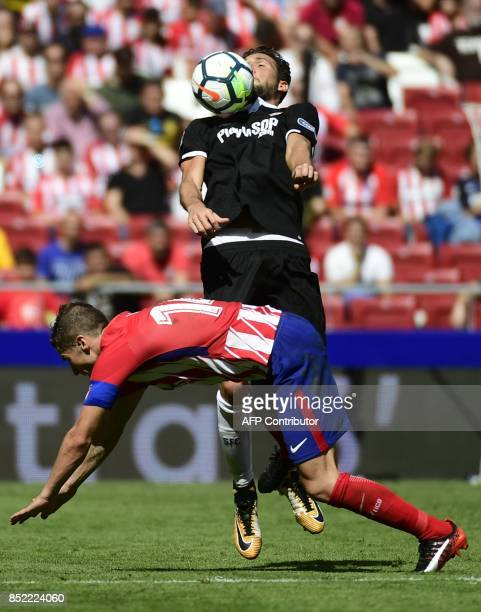 Atletico Madrid's midfielder from Spain Gabi vies with Sevilla's midfielder from Italy Franco Vazquez during the Spanish league football match Club...