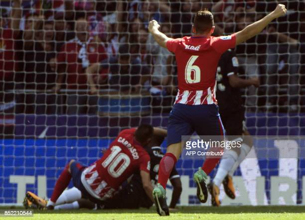 Atletico Madrid's midfielder from Spain Koke celebrates Atletico Madrid's midfielder from Belgium Yannick Ferreira-Carrasco's goal during the Spanish...