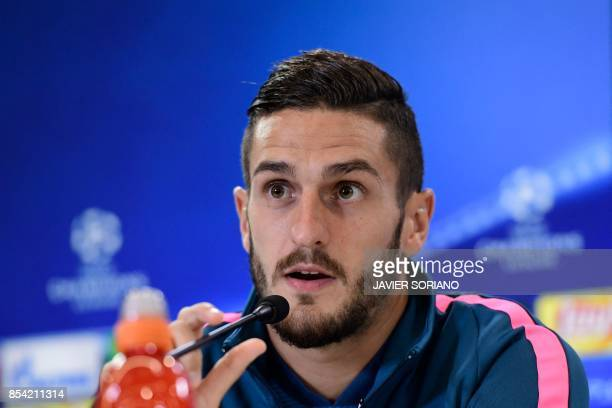Atletico Madrid's midfielder from Spain Koke speaks during a press conference at the Wanda Metropolitano stadium in Madrid on September 26, 2017 on...