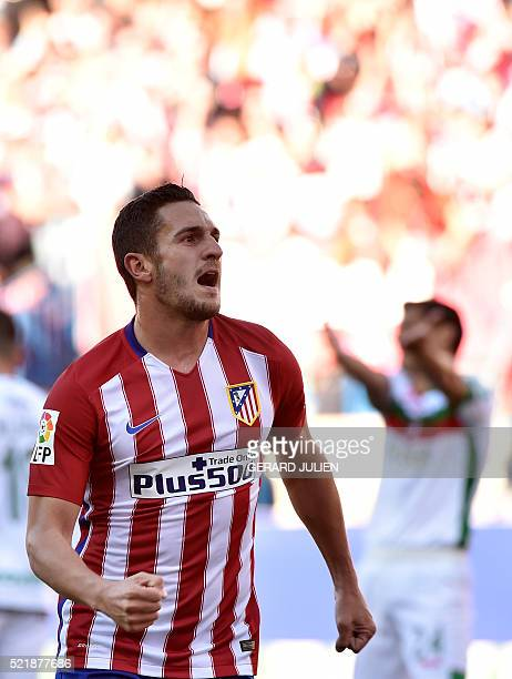 Atletico Madrid's midfielder Koke celebrates after scoring during the Spanish league football match Atletico de Madrid vs Granada CF at the Vicente...