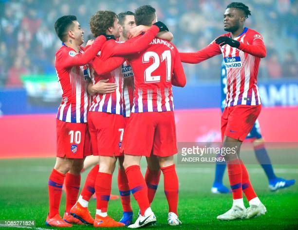 Atletico Madrid's midfielder Koke celebrates with teammates after scoring during the Spanish League football match between SD Huesca and Atletico...