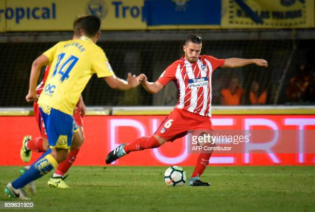 Atletico Madrid's midfielder Koke shoots to score during the Spanish league football match UD Las Palmas vs Club Atletico de Madrid at the Gran...