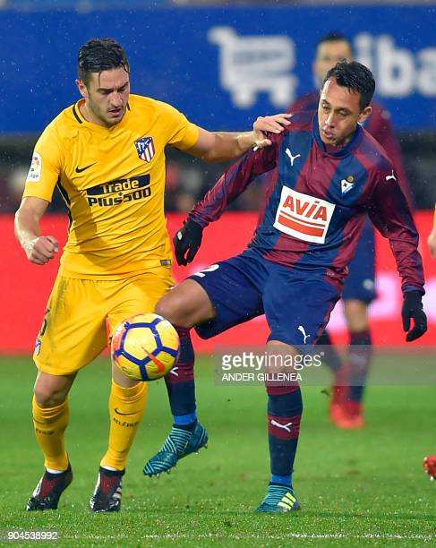 Atletico Madrid's midfielder Koke vies with Eibar's Chilean forward Fabian Orellana during the Spanish league football match between SD Eibar and...