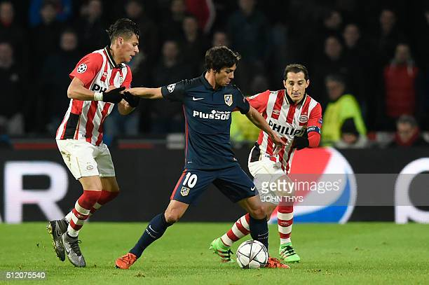 Atletico Madrid's midfielder Oliver Torres fights for the ball with PSV Eindhoven's Mexican defender Hector Moreno and PSV Eindhoven's Mexican...