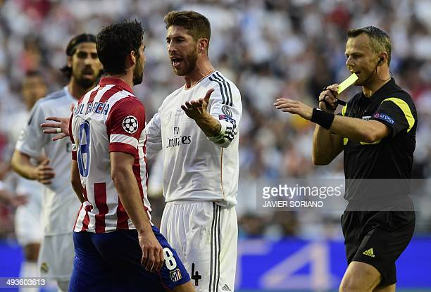Atletico Madrid's midfielder Raul Garcia argues with Real Madrid's defender Sergio Ramos during the UEFA Champions League Final Real Madrid vs...