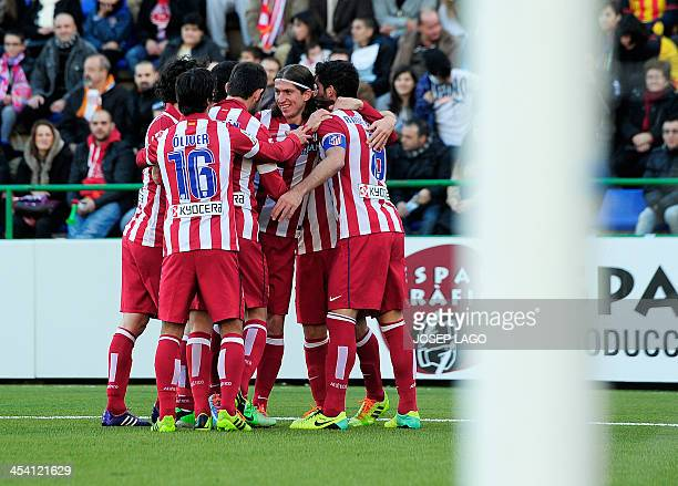 Atletico Madrid's midfielder Raul Garcia is congratulated by his teammates after scoring during the Spanish Copa del Rey finals stage match UE Sant...
