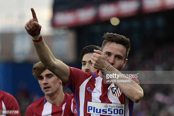 Atletico Madrid's midfielder Saul Niguez celebrates after scoring during the Spanish league football match Club Atletico de Madrid vs UD Las Palmas...