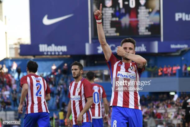 Atletico Madrid's midfielder Saul Niguez celebrates after scoring during the Spanish league football match Club Atletico de Madrid vs SD Eibar at the...