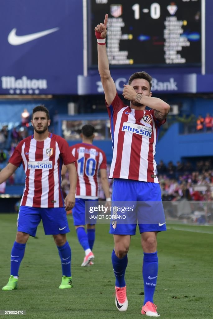 Atletico Madrid's midfielder Saul Niguez (R) celebrates after scoring during the Spanish league football match Club Atletico de Madrid vs SD Eibar at the Vicente Calderon stadium in Madrid on May 6, 2017. /
