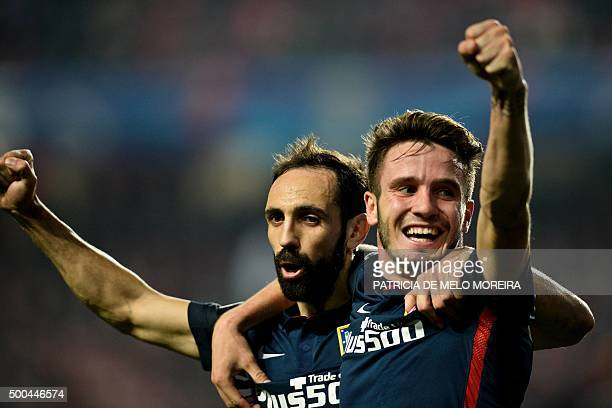 Atletico Madrid's midfielder Saul Niguez celebrates with Atletico Madrid's defender Juanfran after scoring a goal against SL Benfica during the UEFA...