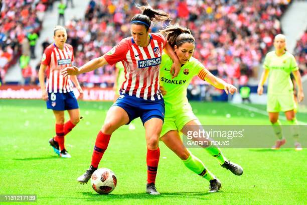 Atletico Madrid's midfielder Silvia Meseguer vies with Barcelona FC's midfielder Vicky Losada during the Spanish league football match between Club...