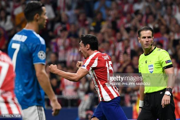 Atletico Madrid's Montenegrin defender Stefan Savic celebrates after scoring a goal during the UEFA Champions League Group D football match between...