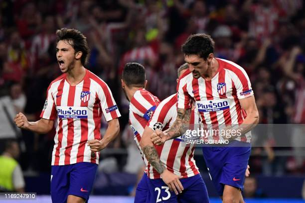 Atletico Madrid's Montenegrin defender Stefan Savic celebrates with Atletico Madrid's Portuguese forward Joao Felix after scoring celebrates after...