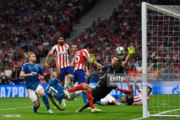 Atletico Madrid's Montenegrin defender Stefan Savic scores a goal during the UEFA Champions League Group D football match between Atletico Madrid and...