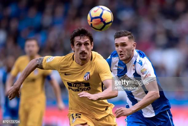 Atletico Madrid's Montenegrin defender Stefan Savic vies with Deportivo La Coruna's Spanish forward Lucas Perez during the Spanish league footbal...