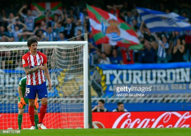 Atletico Madrid's Montenegrin defender Stefan Savic walks on the field after Real Sociedad goal during the Spanish league football between Real...