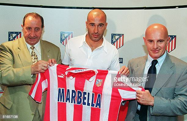 Atletico Madrid's new coach and former Italian soccer coach Arrigo Sacchi Atletico's president Jesus Gil and Atletico's new player Stefano Torrisi...