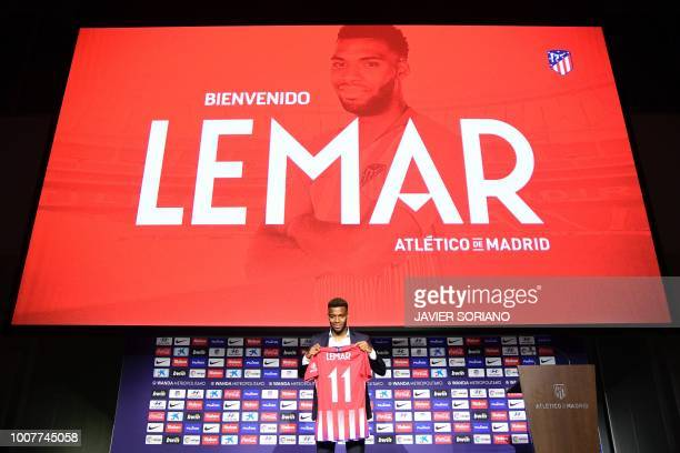 Atletico Madrid's new French midfielder Thomas Lemar poses with his new jersey during his official presentation at the Wanda Metropolitano Stadium in...
