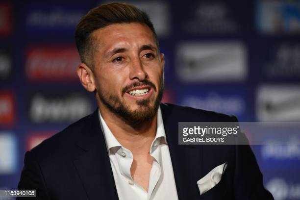 Atletico Madrid's new Mexican midfielder Hector Herrera smiles during his official presentation by the Spanish football club at the Wanda...