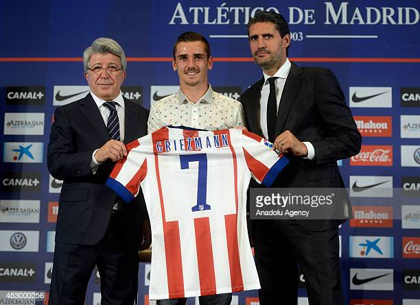 Atletico Madrid's new player French Antoine Griezmann poses with Atletico Madrid's president Enrique Cerezo and team's sports director Jose Luis...