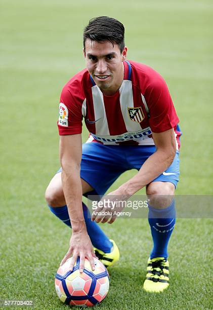 Atletico Madrid's new player Nicolas Gaitan poses with a ball during his presentation ceremony at Vicente Calderon Stadium in Madrid Spain on July 19...