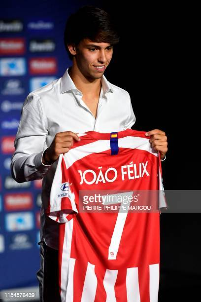 Atletico Madrid's new Portuguese midfielder Joao Felix holds his new jersey during his official presentation at the Wanda Metropolitan stadium in...