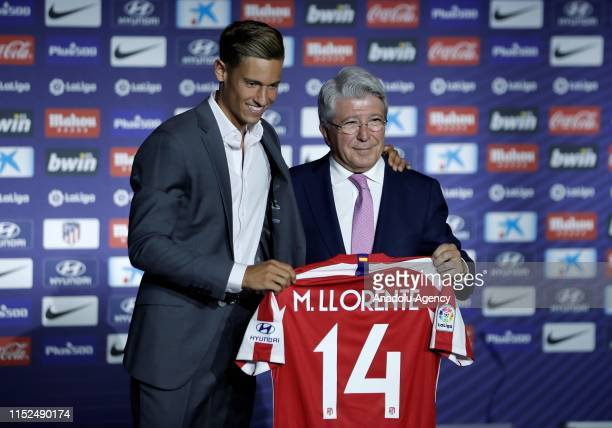 Atletico Madrid's new signing Marcos Llorente poses with the President of Atletico Madrid Enrique Cerezo during his presentation at Wanda...