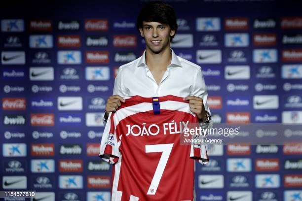 Atletico Madrid's new transfer Portuguese Joao Felix poses for a photo with his jersey during his presentation in Madrid Spain on July 08 2019...