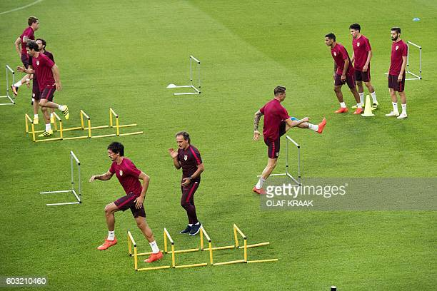 TOPSHOT Atletico Madrid's players attend a training session in Eindhoven on September 12 on the eve of the UEFA Champions League football match...