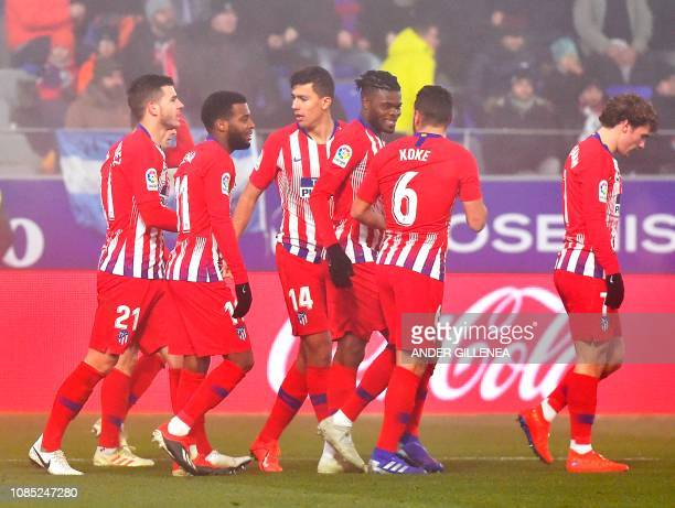 Atletico Madrid's players celebrate after Atletico Madrid's Colombian defender Santiago Arias scored a goal during the Spanish League football match...