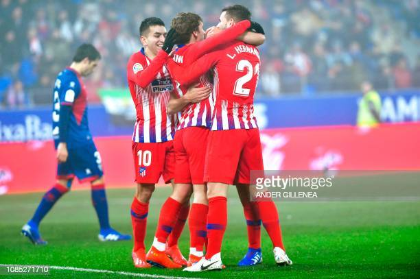 Atletico Madrid's players celebrate after Atletico Madrid's midfielder Koke scored during the Spanish League football match between SD Huesca and...