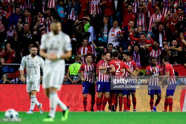 TOPSHOT Atletico Madrid's players celebrate after scoring a goal during the UEFA Super Cup football match between Real Madrid and Atletico Madrid at...