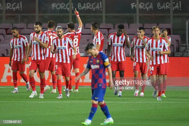 Atletico Madrid's players celebrate after scoring a goal during the Spanish League football match between FC Barcelona and Club Atletico de Madrid at...