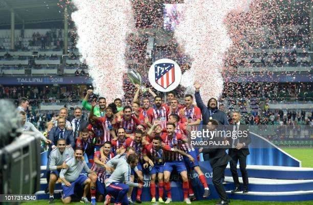Atletico Madrid's players celebrate after winning the UEFA Super Cup football match Atletico de Madrid vs Real Madrid CF at the Lillekula Stadium in...
