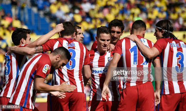 Atletico Madrid's players celebrate the opener during the Spanish league football match UD Las Palmas vs Club Atletico de Madrid at the Gran Canaria...