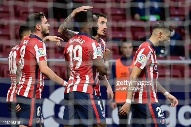Atletico Madrid's players celebrate their second goal during the Spanish League football match between Atletico Madrid and SD Huesca at the Wanda...